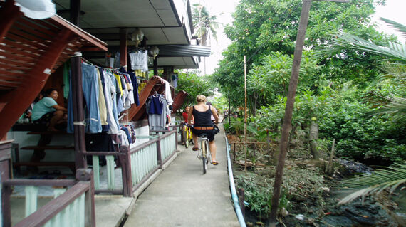 A girl cycling through Bangkok mangrove